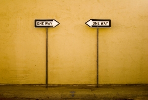 two one way signs facing each other